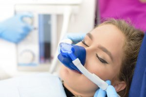A girl inhaling dental sedation