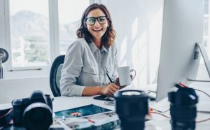 Smiling woman ta office