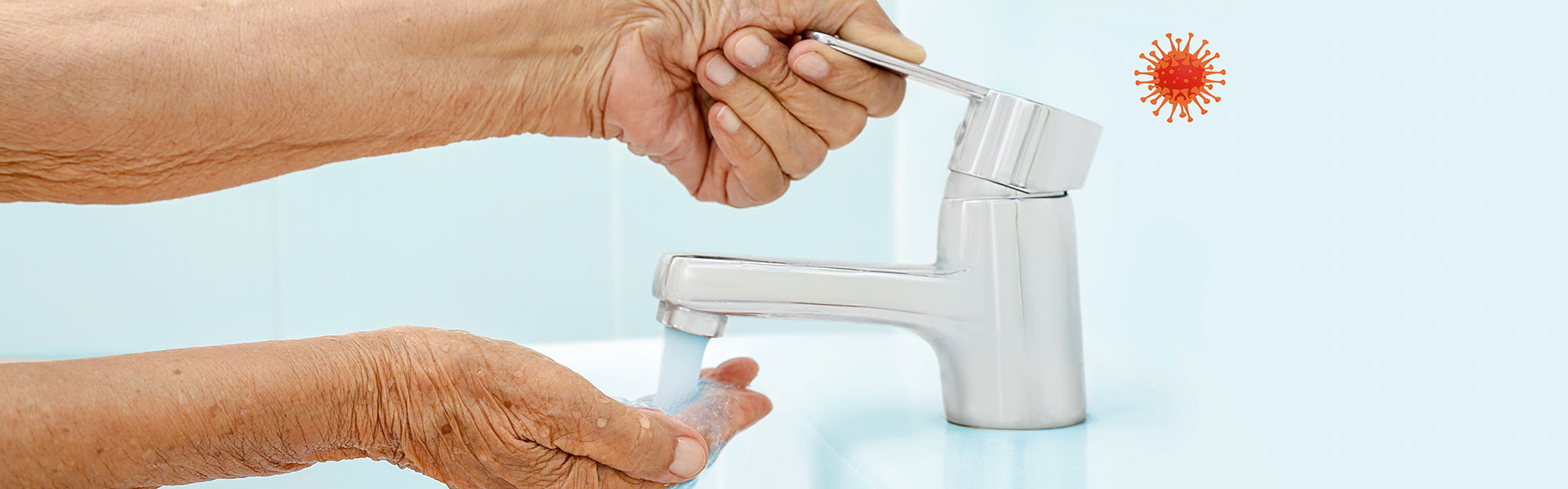 A person washing her hand
