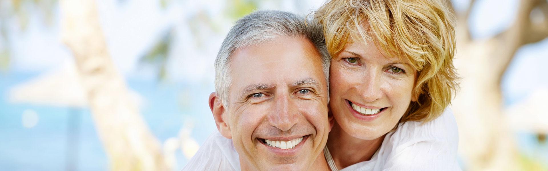Happy elderly couple who had Implant Retained Dentures