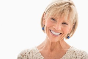Oral cancer free middle age woman smiling