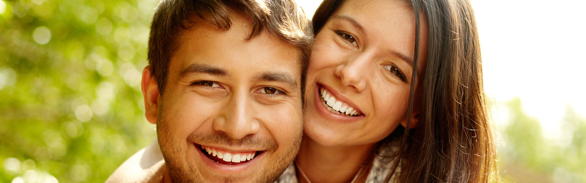 Happy couple having root canal treatment