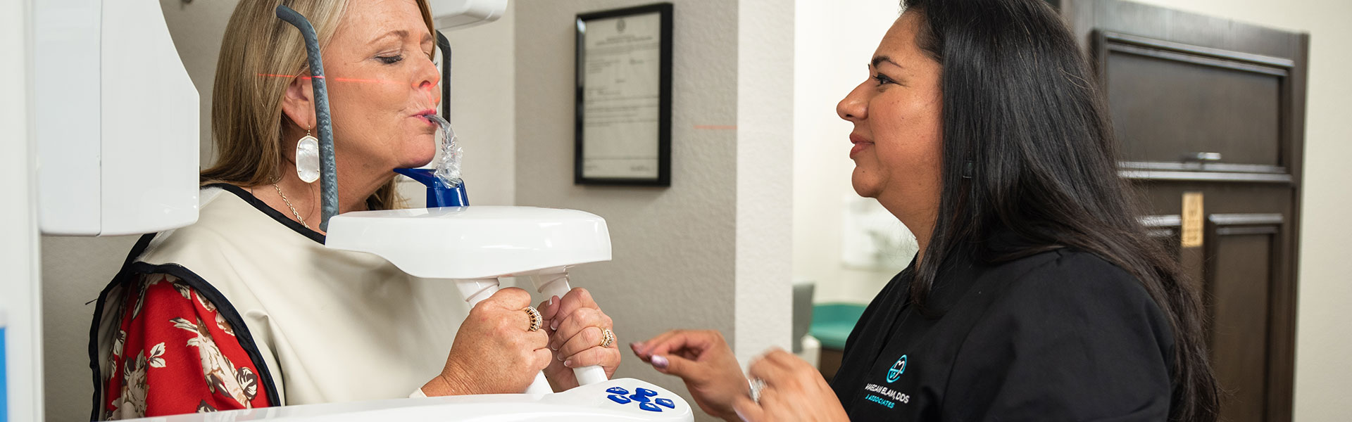A patient trying out new dental equipments at Maegan Elam, DDS & Associates